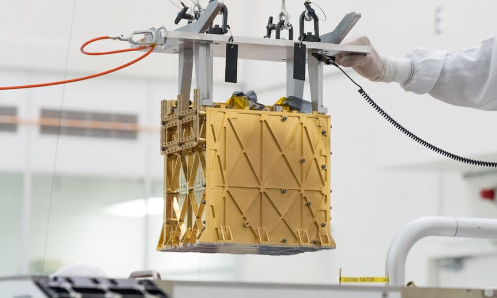 Technicians in the cleanroom installing the MOXIE instrument into the Perseverance rover. Credit: NASA/JPL-Caltech